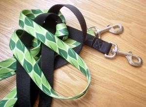 pet leashes one black leash and one leash with dark green and light green leaves